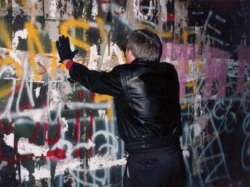 Dick Eastman praying at Berlin wall