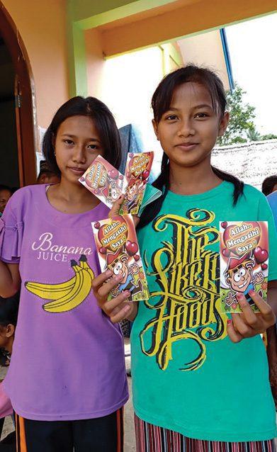Young girls receiving gospel literature