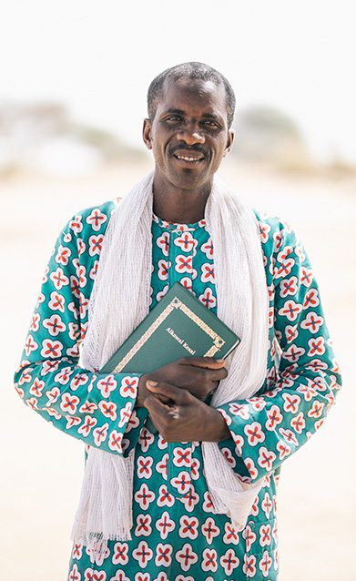Man holding bible in chad