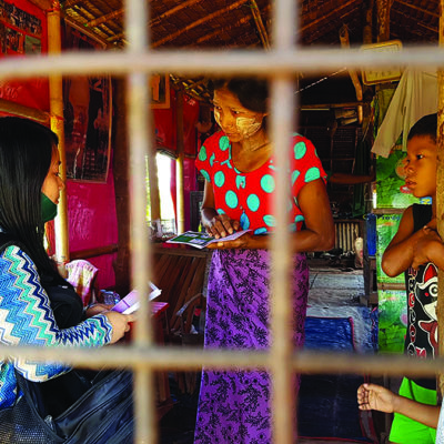 Missionary sharing the gospel with family in Myanmar
