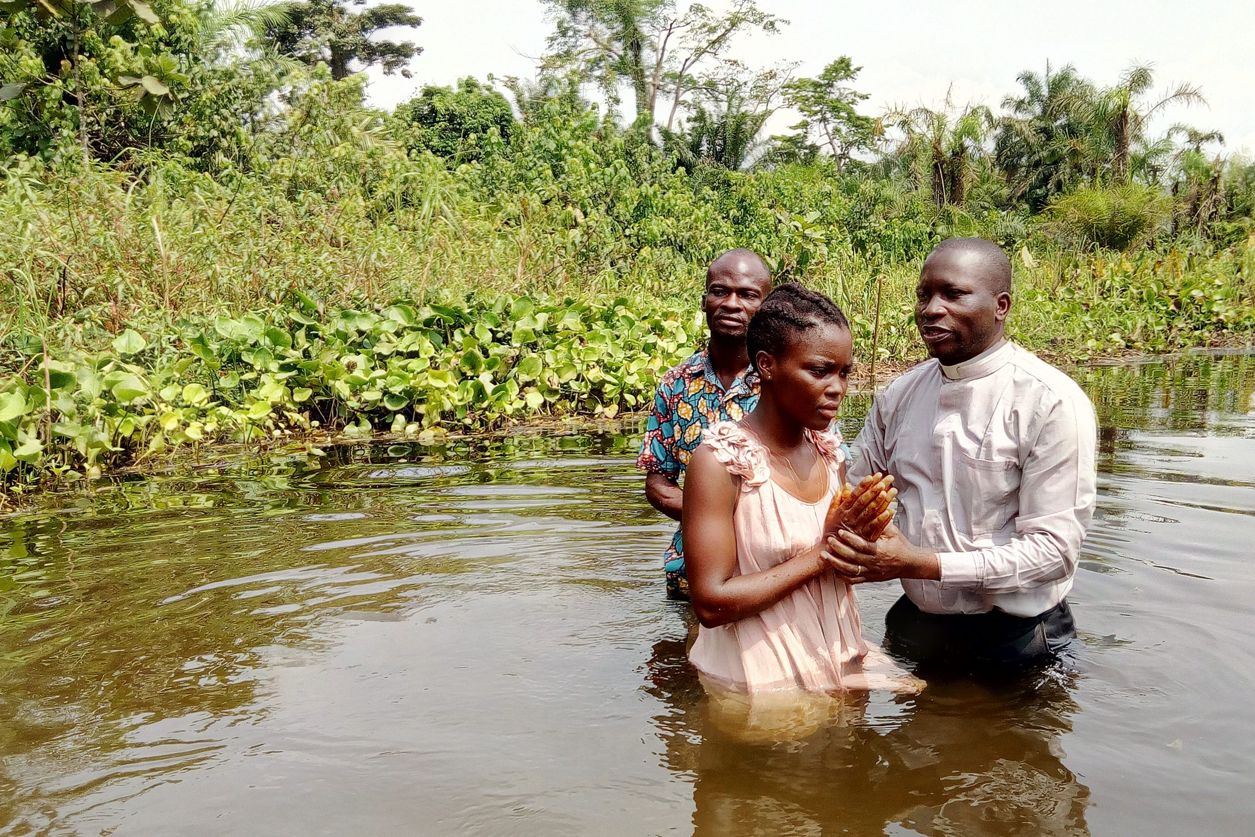 A woman is baptized in the Democratic Republic of Congo